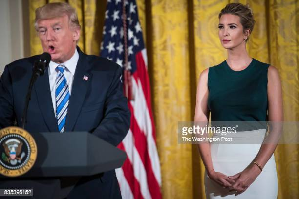 Ivanka Trump listens as her father President Donald Trump speaks to small business owners as part of 'American Dream Week' in the East Room of the...