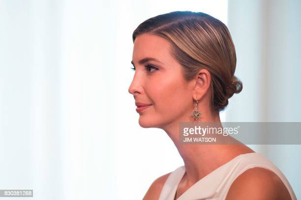 Ivanka Trump listens as her father US President Donald Trump speaks to the press on August 11 at his Bedminster National Golf Club in New Jersey /...