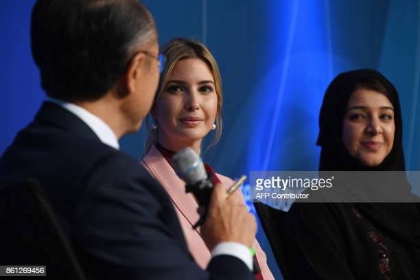 Ivanka Trump listens to World Bank President Jim Yong Kim as she attends with Reem al Hashimy the United Arab Emirates Minister of State for...