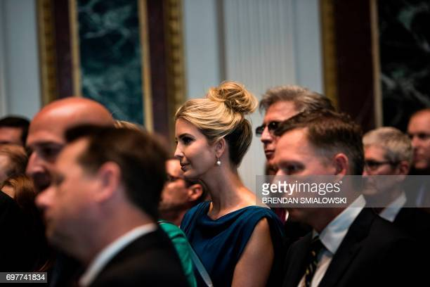 Ivanka Trump listens while her husband Senior Advisor Jared Kushner speaks during an event with technology sector CEOs at the White House on June 19...