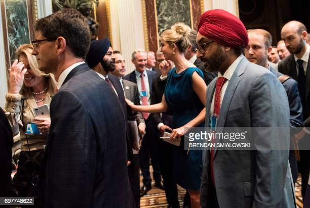 Ivanka Trump speaks with Ajaypal Singh Banga CEO of Mastercard as others leave after Senior Advisor Jared Kushner spoke during an event with...