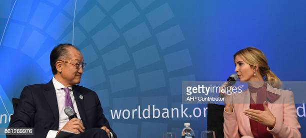 Ivanka Trump speaks with World Bank President Jim Yong Kim during a session named 'Taking womenowned businesses to the next level' as part of the...