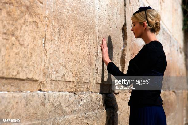 TOPSHOT Ivanka Trump the daughter of US President Donald Trump prays at the Western Wall the holiest site where Jews can pray in Jerusalems Old City...