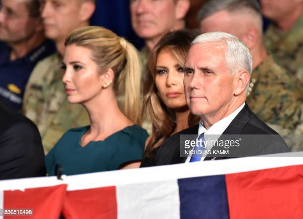 Ivanka Trump US First Lady Melania Trump and US Vice President Mike Pence await the arrival of US President Donald Trump to Joint Base MyerHenderson...