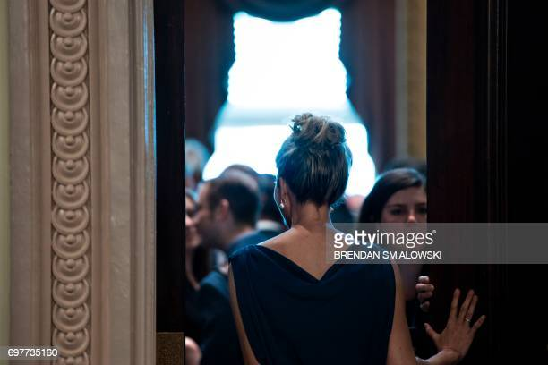 Ivanka Trump walks to a meeting with her husband Senior Advisor Jared Kushner and technology sector CEOs at the White House June 19 2017 in...