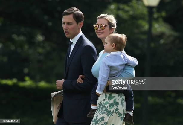 Ivanka Trump walks with husband Jared Kushner and son Theodore James Kushner towards the Marine One on the South Lawn of the White House prior to a...