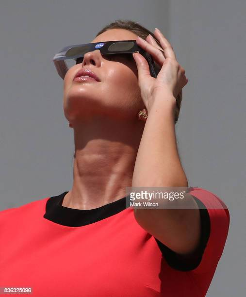 Ivanka Trump wears special glasses to view the solar eclipse at the White House on August 21 2017 in Washington DC Millions of people have flocked to...