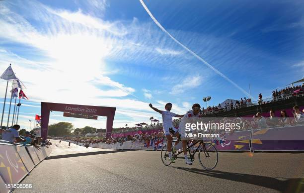 Ivano and Lucca Pizzi of Italy celebrate winning the Men's Individual B Cycling Road Race on day 10 of the London 2012 Paralympic Games at Brands...