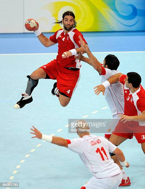 Ivano Balic of Croatia jumps to pass the ball during the Men's Handball Bronze Medal Match between Croatia and Spain held at the National Indoor...