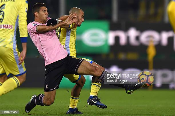Ivaylo Chochev of Palermo and Ahmad Benali of Pescara compete for the ball during the Serie A match between US Citta di Palermo and Pescara Calcio at...