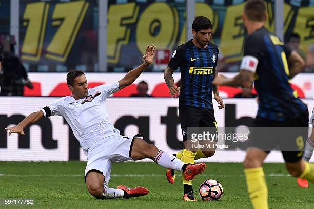 Ivaylo Chochev of Palermo and Ever Banega of Internazionale compete for the ball during the Seria A match between FC Internazionale and US Citta di...