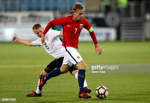 Iver Fossum of Norway and Phillipp Ochs of Germany battle for the ball during the UEFA Under21 Euro 2019 Qualifier match between U21 of Norway and...
