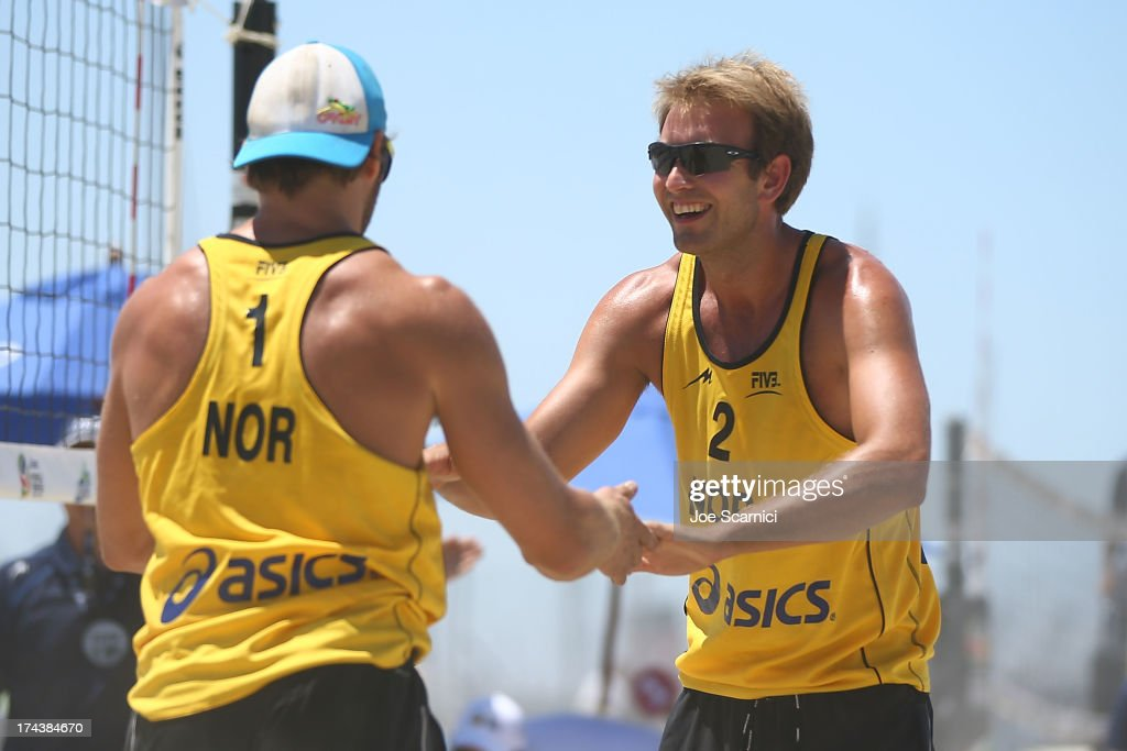 Iver Horrem and Geir Eithun of Norway celebrate a point during the round of pool play at the ASICS World Series of Beach Volleyball - Day 3 on July 24, 2013 in Long Beach, California.