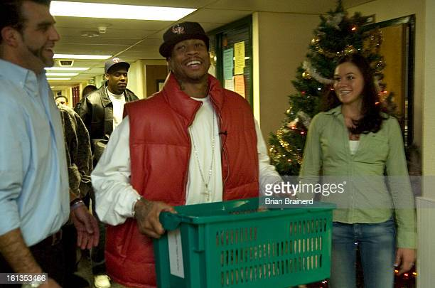 iverson17_bb_12 Nuggets basketball star Allen Iverson played Santa Monday night at Warren Village where he delivered holiday meal food baskets to one...
