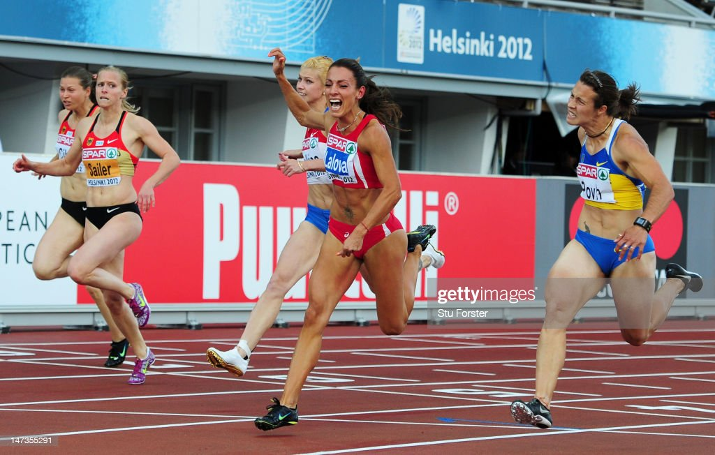 <a gi-track='captionPersonalityLinkClicked' href=/galleries/search?phrase=Ivet+Lalova&family=editorial&specificpeople=2353598 ng-click='$event.stopPropagation()'>Ivet Lalova</a> of Bulgaria beats <a gi-track='captionPersonalityLinkClicked' href=/galleries/search?phrase=Olesya+Povh&family=editorial&specificpeople=7119125 ng-click='$event.stopPropagation()'>Olesya Povh</a> of Ukraine in the Women's 100 Metres Final during day two of the 21st European Athletics Championships at the Olympic Stadium on June 28, 2012 in Helsinki, Finland