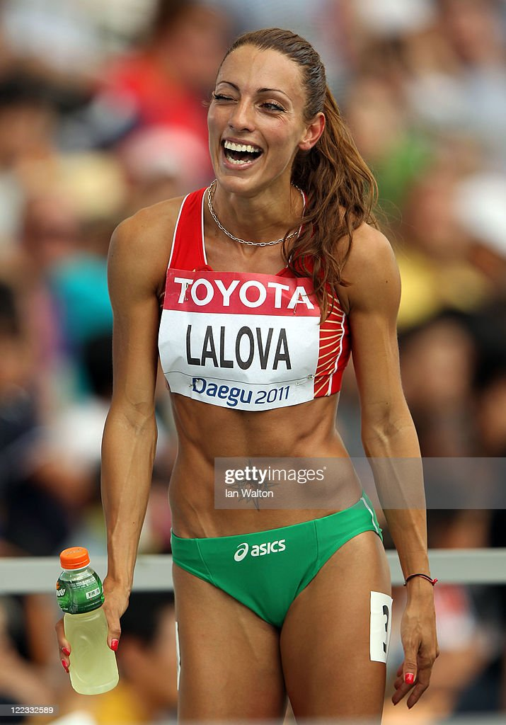 <a gi-track='captionPersonalityLinkClicked' href=/galleries/search?phrase=Ivet+Lalova&family=editorial&specificpeople=2353598 ng-click='$event.stopPropagation()'>Ivet Lalova</a> of Bulgaria smiles afer winning her women's 100 metres heats during day two of the 13th IAAF World Athletics Championships at the Daegu Stadium on August 28, 2011 in Daegu, South Korea.