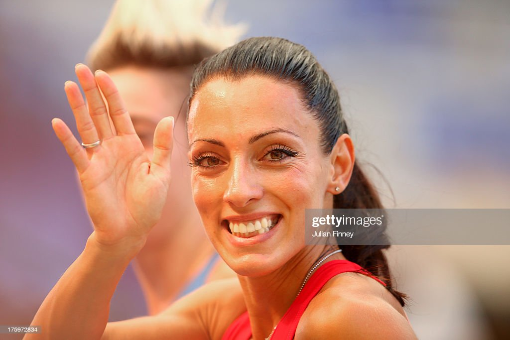 <a gi-track='captionPersonalityLinkClicked' href=/galleries/search?phrase=Ivet+Lalova&family=editorial&specificpeople=2353598 ng-click='$event.stopPropagation()'>Ivet Lalova</a> of Bulgaria waves as she competes in the Women's 100 metres heats during Day Two of the 14th IAAF World Athletics Championships Moscow 2013 at Luzhniki Stadium on August 11, 2013 in Moscow, Russia.