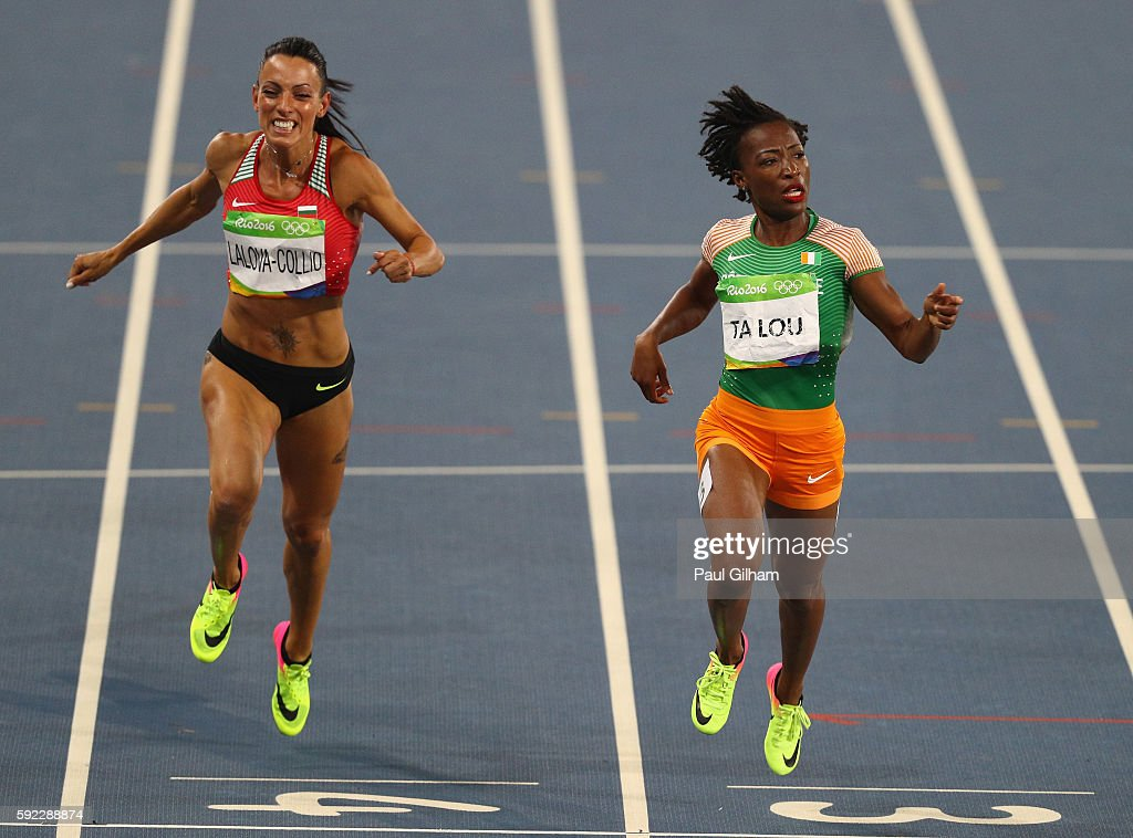 Ivet LalovaCollio of Bulgaria and MarieJosee Ta Lou of the Ivory Coast compete during the Women's 200m semifinal on Day 11 of the Rio 2016 Olympic...