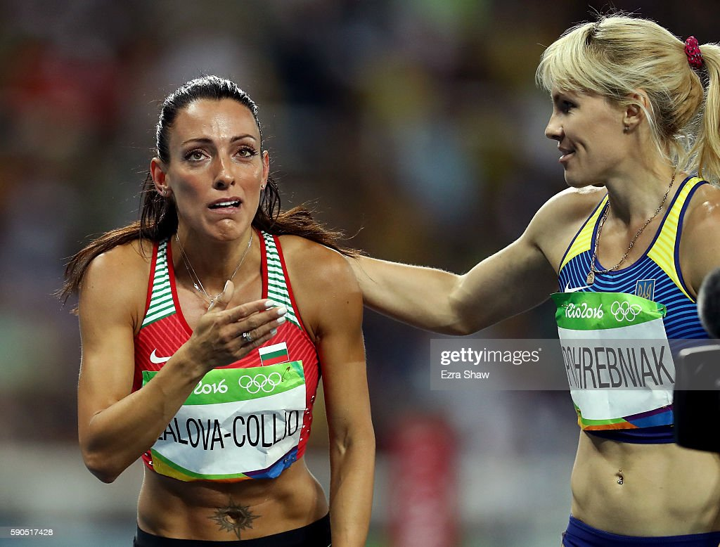 Ivet LalovaCollio of Bulgaria and Natalia Pohrebniak of Ukraine react during the Women's 200m Semifinals on Day 11 of the Rio 2016 Olympic Games at...