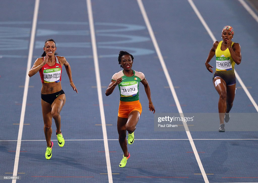 Ivet LalovaCollio of Bulgaria MarieJosee Ta Lou of the Ivory Coast and Angela Tenorio of Ecuador compete during the Women's 200m on Day 11 of the Rio...