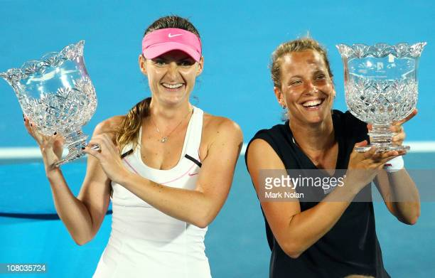 Iveta Benesova and Barbora Zahlavova Strycova of the Czech Republic hold trophies after winning the womens doubles final against Kveta Peschke of the...