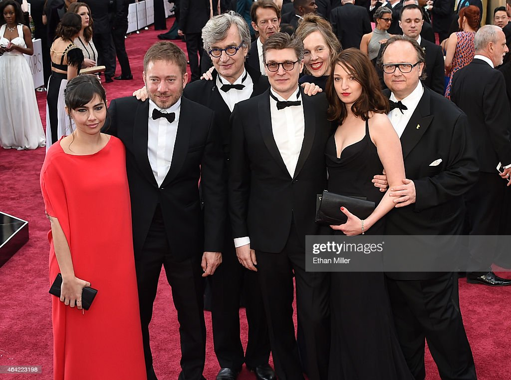 Ivi Roberg directors Juliano Ribeiro Salgado Wim Wenders writer David Rosier Donata Wender and guests attend the 87th Annual Academy Awards at...