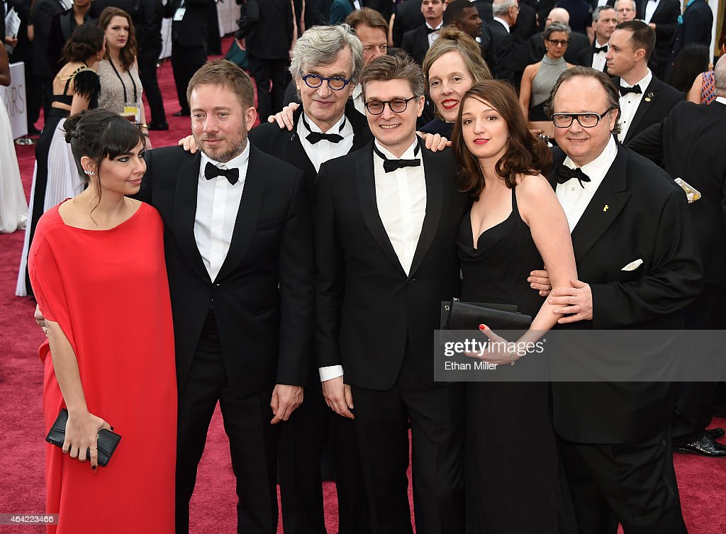 Ivi Roberg flmmakers Juliano Ribeiro Salgado Wim Wenders David Rosier Donata Wenders and guests attend the 87th Annual Academy Awards at Hollywood...