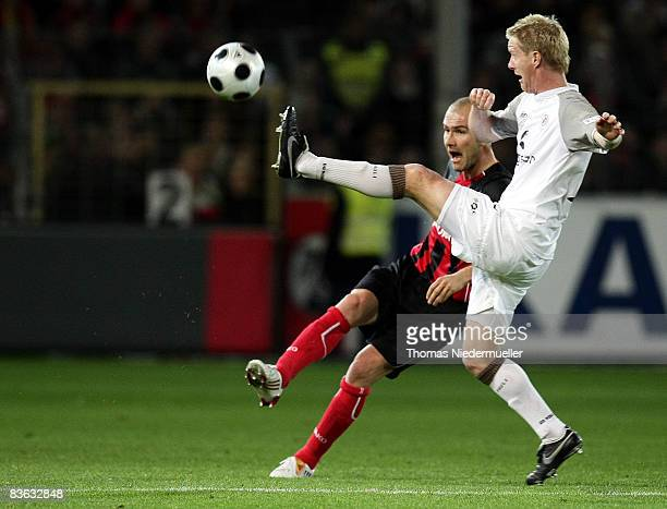 Ivica Banovic of Freiburg battles for the ball with Timo Schultz of St Pauli during the Second Bundesliga match between SC Freiburg and FC St Pauli...