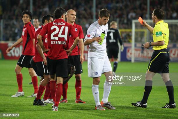 Ivica Banovic of Freiburg is sent of by referee Felix Zwayer during the Bundesliga match between SC Freiburg and FC Schalke 04 at the Badenova...