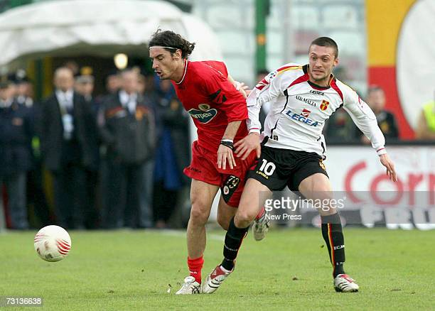 Ivica Iliev of Messina competes with Matteo Melara Ascoli celebrate during the Seria A match between Messina and Ascoli at Stadio G Celeste January...