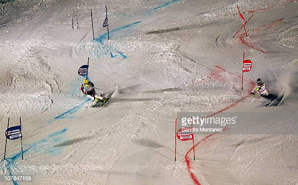 Ivica Kostelic of Croatia and Julien Lizeroux of France compete during the final in the Parallel Slalom of the FIS Skiing World Cup at the Olympic...