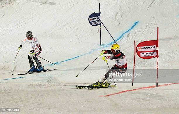 Ivica Kostelic of Croatia and Julien Lizeroux of France speed down the slope during the Parallel Slalom final race of the FIS Skiing World Cup at the...