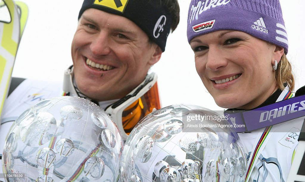 Ivica Kostelic of Croatia and Maria Riesch of Germany celebrate winning the Overall World Cup globes on March 19 2011 in Lenzerheide Switzerland