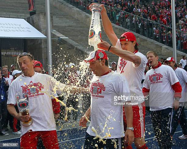 Ivica Olic and Daniel van Buyten of Bayern celebrate winning the German champions trophy after winning 31 the Bundesliga match between Hertha BSC...