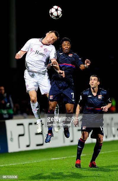Ivica Olic of Bayern Muenchen and Michel Bastos of Olympique Lyonnais compete for a header during the UEFA Champions League semi final second leg...