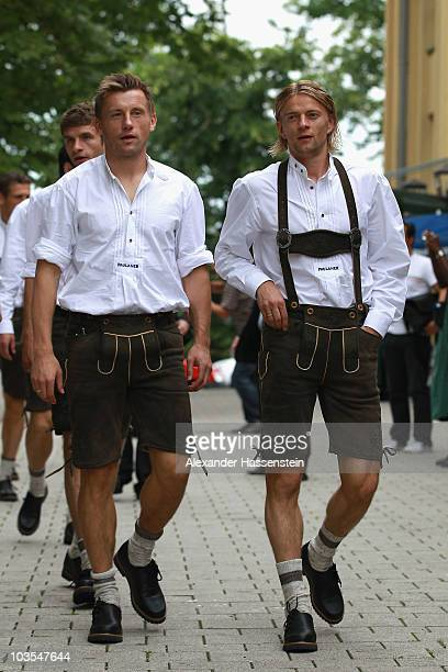 Ivica Olic of Bayern Muenchen arrives with his team mate Anatoliy Tymoshchuk for the Paulaner photocall at the Nockerberg Biergarden on August 23...