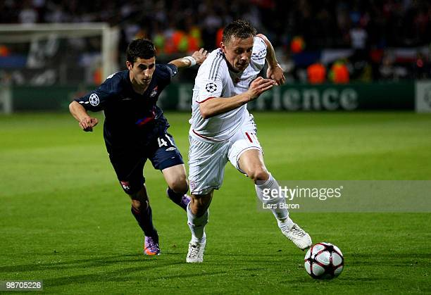 Ivica Olic of Bayern Muenchen is pursued by Maxime Gonalons of Olympique Lyonnais during the UEFA Champions League semi final second leg match...