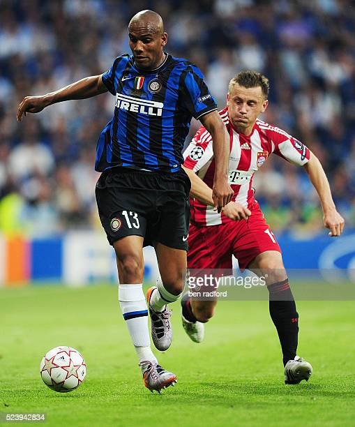 Ivica Olic of Bayern Munich chases Maicon of Inter Milan during the UEFA Champions League Final between Bayern Munich and Inter Milan at the Estadio...