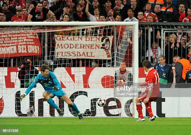 Ivica Olic of Bayern puts the ball past of Manchester to score the second goal during the UEFA Champions League quarter final first leg match between...