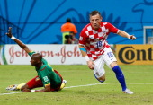 Ivica Olic of Croatia celebrates after scoring his team's first goal during the 2014 FIFA World Cup Brazil Group A match between Cameroon and Croatia...