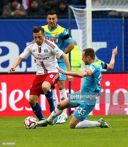 Ivica Olic of Hamburg and Matthias Lehmann of Koeln battle for the ball during the Bundesliga match between Hamburger SV and 1 FC Koeln at Imtech...