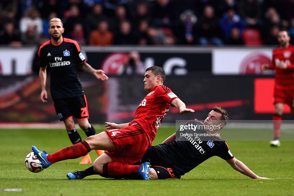 <a gi-track='captionPersonalityLinkClicked' href=/galleries/search?phrase=Ivica+Olic&family=editorial&specificpeople=547277 ng-click='$event.stopPropagation()'>Ivica Olic</a> of Hamburger SV challenges <a gi-track='captionPersonalityLinkClicked' href=/galleries/search?phrase=Kyriakos+Papadopoulos&family=editorial&specificpeople=5446261 ng-click='$event.stopPropagation()'>Kyriakos Papadopoulos</a> of Bayer Leverkusen during the Bundesliga match between Bayer 04 Leverkusen and Hamburger SV at BayArena on April 4, 2015 in Leverkusen, Germany.