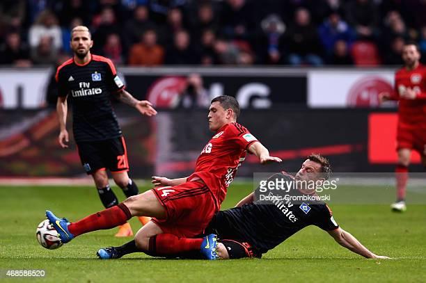 Ivica Olic of Hamburger SV challenges Kyriakos Papadopoulos of Bayer Leverkusen during the Bundesliga match between Bayer 04 Leverkusen and Hamburger...