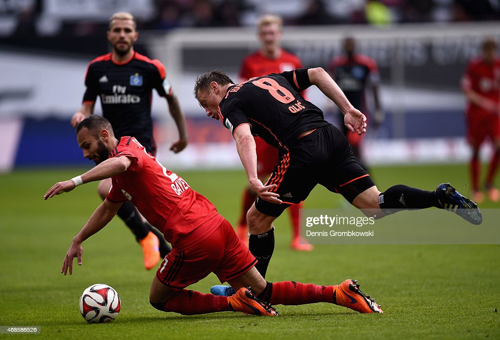 <a gi-track='captionPersonalityLinkClicked' href=/galleries/search?phrase=Ivica+Olic&family=editorial&specificpeople=547277 ng-click='$event.stopPropagation()'>Ivica Olic</a> of Hamburger SV challenges <a gi-track='captionPersonalityLinkClicked' href=/galleries/search?phrase=Oemer+Toprak&family=editorial&specificpeople=5395932 ng-click='$event.stopPropagation()'>Oemer Toprak</a> of Bayer Leverkusen during the Bundesliga match between Bayer 04 Leverkusen and Hamburger SV at BayArena on April 4, 2015 in Leverkusen, Germany.