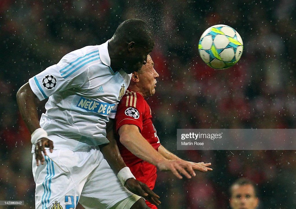 Ivica Olic of Muenchen and Rod Fanni of Marseille head for the ball during the UEFA Champions League quarterfinal second leg match at Allianz Arena...