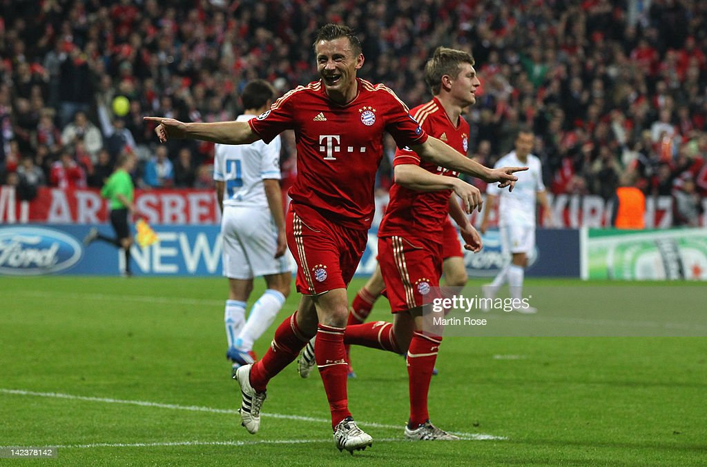 Ivica Olic of Muenchen celebrates after he scores his team's opening goal during the UEFA Champions League quarterfinal second leg match at Allianz...