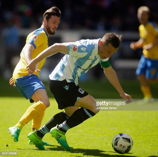 Ivica Olic of Muenchen fights for the Ball with Quirin Moll of Braunschweig during the Second Bundesliga match between TSV 1860 Muenchen and...