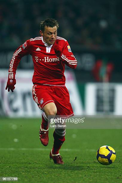 Ivica Olic of Muenchen runs with the ball during the Bundesliga match between SV Werder Bremen and FC Bayern Muenchen at Weser Stadium on January 23...