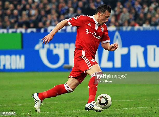 Ivica Olic of Muenchen runs with the ball during the Bundesliga match between FC Schalke 04 and FC Bayern Muenchen at the Veltins Arena April 3 2010...