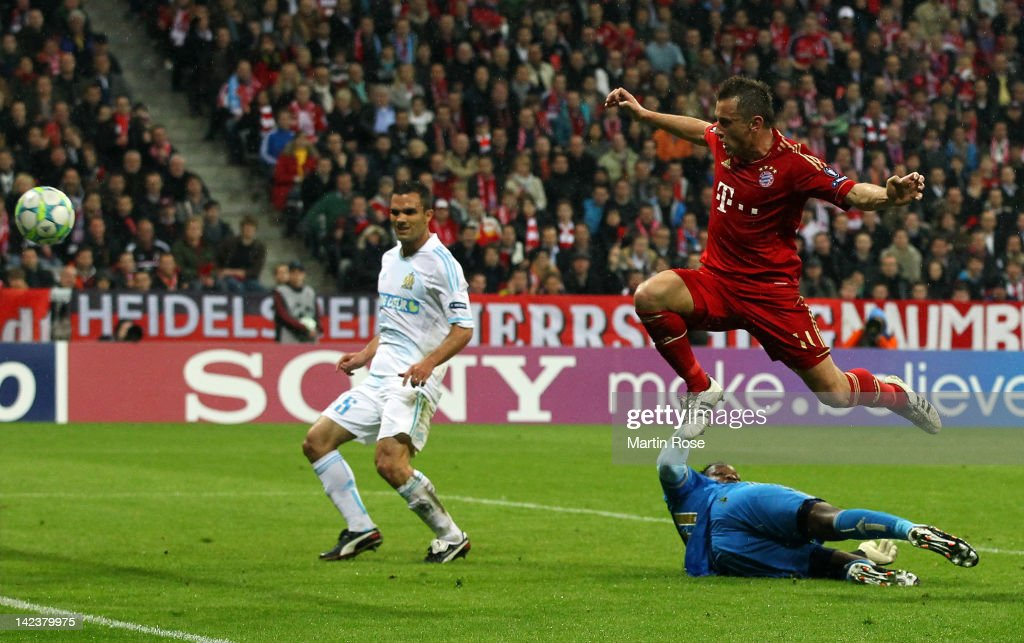 Ivica Olic (R) of Muenchen scores his team's 2nd goal during the UEFA Champions League quarter-final second leg match at Allianz Arena on April 3, 2012 in Munich, Germany.